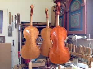 Three violins back