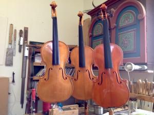 Three violins front
